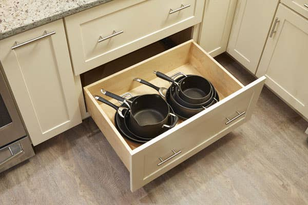 CliqStudios dayton style pots and pans deep drawer Painted Linen cabinet with stacked cookware