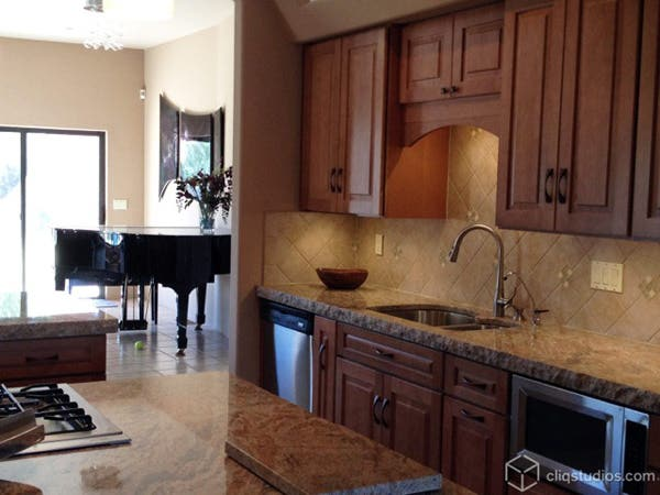Maple kitchen cabinets by sink area