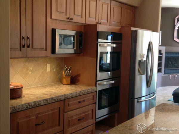 Maple kitchen cabinets by oven area