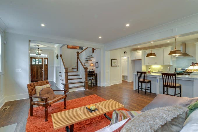 Open floor plan with white Shaker galley kitchen