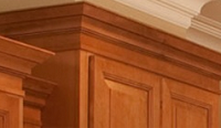 top of maple cabinets trimmed with deep crown molding
