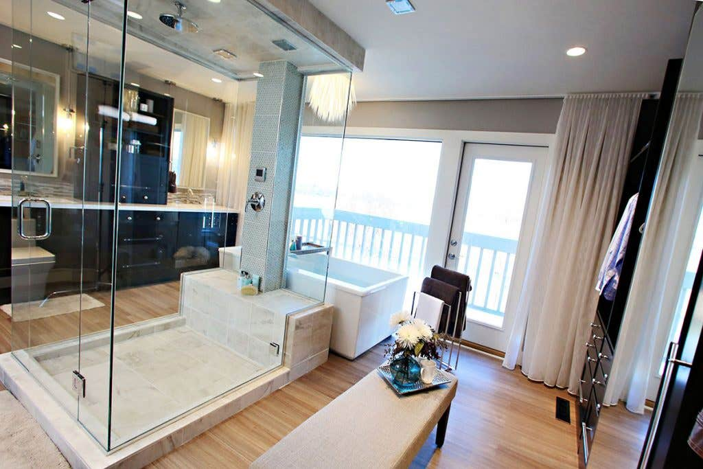 Open-concept bathroom combining shower, floating bath, double vanity, and dressing closet.