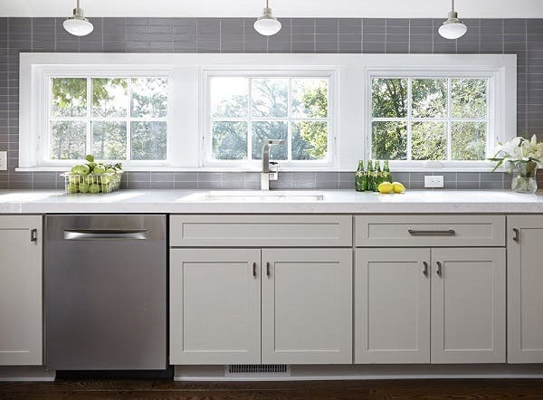Bright, open and neat as a pin, the clean-up zone in this kitchen uses a strategic assortment of storage solutions to keep clutter out of sight.