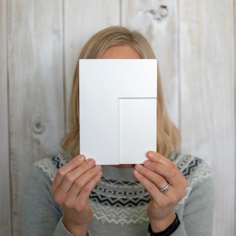 blogger Mimi of Dessert'd Organic Bake Shop holding a white CliqStudios cabinet sample