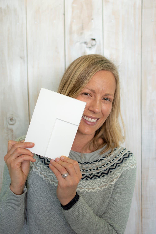 Mimi of blog Dessert'd holding a cabinet sample for her new home design