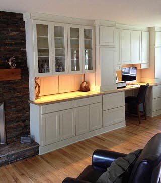 library wall and computer workstation built from white shaker cabinets