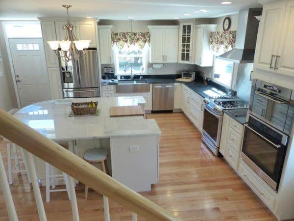 Cape Cod kitchen remodeling project features CliqStudios.com Lyndale raised panel cabinets in painted White finish.