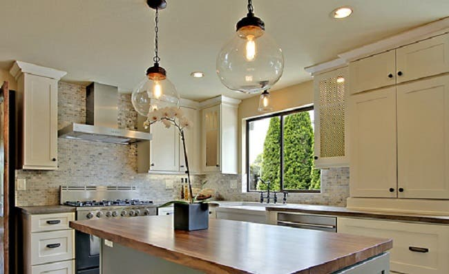 chandelier in windowed corner of kitchen