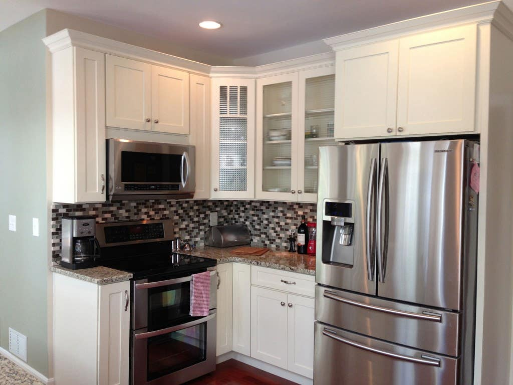 kitchen with white glass door cabinets