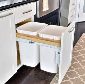 pull-out trash and recycling center in shaker white cabinets