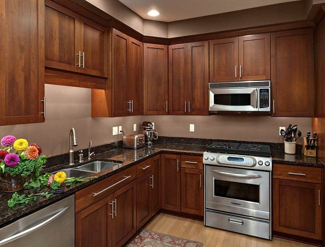 cherry cabinets with undercabinet countertop task lighting